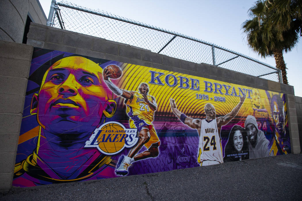 A mural featuring Kobe Bryant and daughter Gianna Bryant, created by Eric Meidenbauer, outside ...
