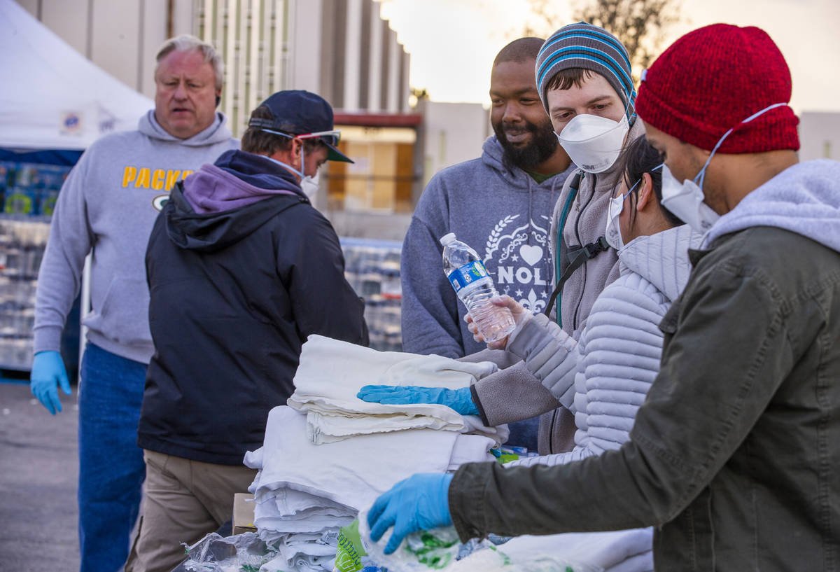 Homeless people who enter receive sheets and water at the temporary shelter in the upper parkin ...