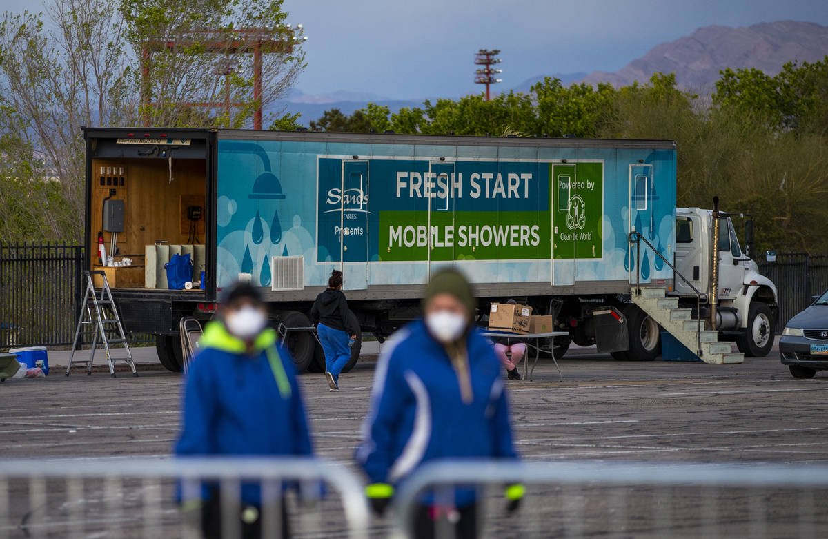 No showers yet but washing is available for the homeless at the temporary shelter in the upper ...