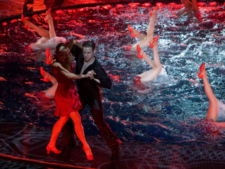 """Le Reve is French for """"the dream,"""" and like many dreams, it takes you into a world of surrealism where you should expect the unexpected. It starts with an aquatic theater in the round which submerges 27 feet and has a 15 foot high raised platform for the gymnasts and swimmers."""