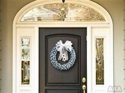 Create a warm and stylish wreath to welcome guests