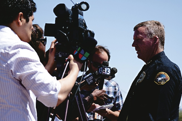 Boulder City Police Chief Thomas Finn speaks with the media.