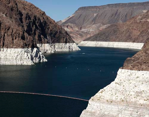 The bleached ring around the canyon just above Hoover Dam shows the water levels of Lake Mead in September, 2008. According to the latest projections from federal forecasters, the reservoir east o ...