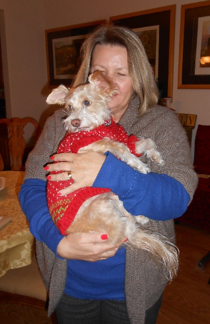 Gabriele Pruitt holds her dog Stacy Jan. 15 at her home near Lone Mountain. Stacy, a rescue terrier mix, had gone missing a year ago and was reunited with the family after a mix-up at the groomer& ...