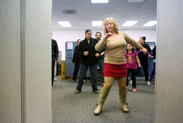 Dance instructor Ixela Gutierrez leads the steps at Muevete Bailando.