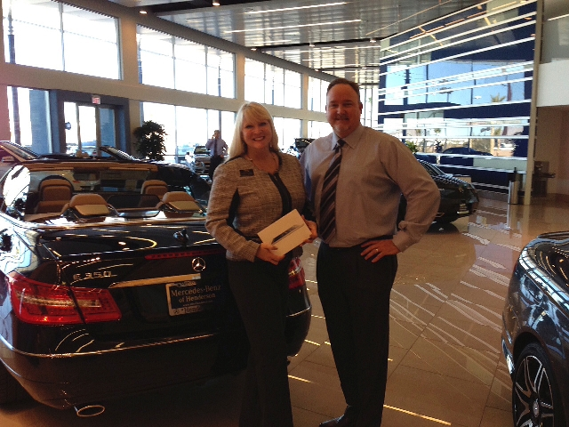 Michelle Burke receives a new iPad from Jim Chaisson Jr., general manager of Mercedes-Benz of Henderson.