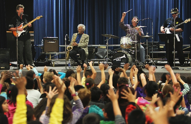 Saxophonist Herb Hardesty performs for students at Gray Elementary School in Las Vegas on Feb. 1. Performing with him are Glen Hammond, left, drummer Jimmy Prima and George Doty. Hardesty, who liv ...