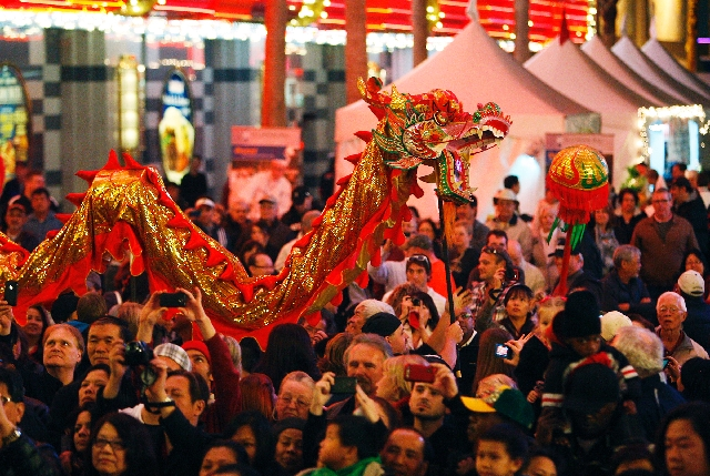 A giant red dragon winds through the crowd Jan. 24, 2012, during the Chinese New Year celebration on Fremont Street. Students from The Meadows School will welcome in the Year of the Snake with a d ...