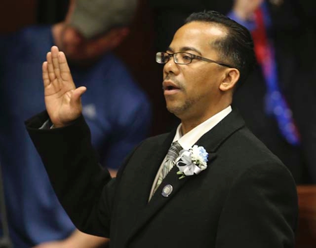 Nevada Assemblyman Steven Brooks, D-North Las Vegas, is shown taking the oath of office during the opening day of the 77th Legislative Session on Feb. 4. Brooks was arrested early Sunday morning i ...