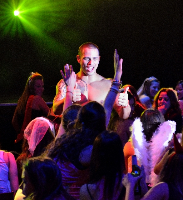"""Aidan Tepukei interacts with the mostly female audience at the """"Thunder From Down Under"""" show at the Excalibur."""