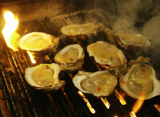 Oysters sizzle on chargrill at Lola's A Louisiana Kitchen on West Charleston Boulevard.
