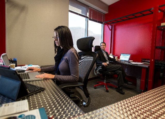 Alert ID marketing director Sharon Traver, left, and CEO Ken Wiles work at the company's Las Vegas office Tuesday. The online and mobile application public safety service said it will partne ...