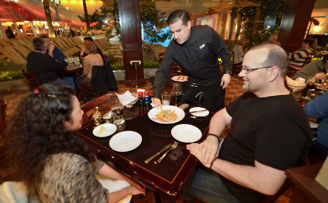 Andy Madrid, center, serves Tomomi Watanabe, left, and Lee Crockett at the Grotto Ristorante in the Golden Nugget.