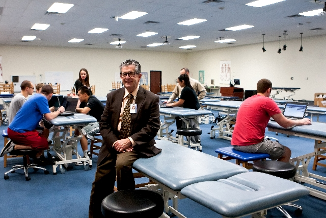Dr. Michael Harter is shown with students working in the lab of Touro University Nevada, located at 874 American Pacific Drive in Henderson