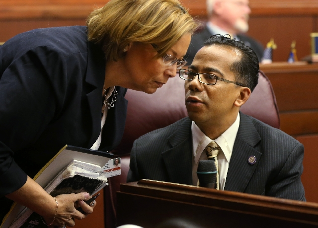 Nevada Assemblyman Steven Brooks, D-North Las Vegas, talks with attaché Robin Carter on the Assembly floor at the Legislative Building in Carson City on Wednesday. Carter is also Brooks&rsq ...