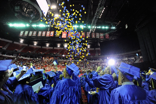 Balloons fall on the graduates at the end of College of Southern Nevada's 40th annual commencement ceremony at the Thomas & Mack Center on May 21, 2012. Community colleges may be a better fi ...
