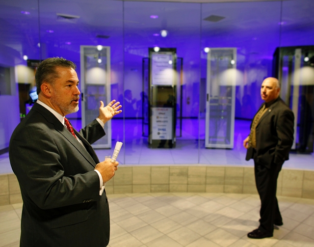 Cobalt Data Centers CEO Mike Ballard, left, gives a tour of the new collocation center Thursday.