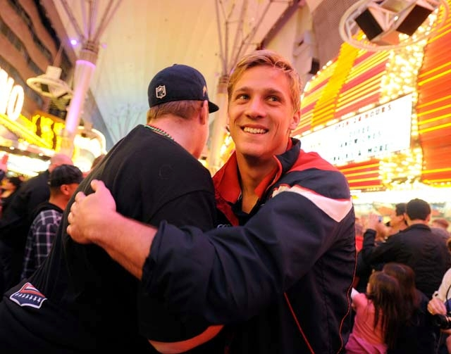 U.S. wing Colin Hawley, right, greets a fan Thursday during the Parade of Nations on Fremont Street. The USA Sevens rugby tournament, which runs today through Sunday at Sam Boyd Stadium, might not ...