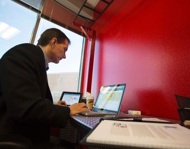 Ken Wiles, CEO of AlertID, a company that emails bulletins to members to warn them of area crimes or emergencies, works Tuesday in his office. Today, AlertID's notification area covers nearl ...