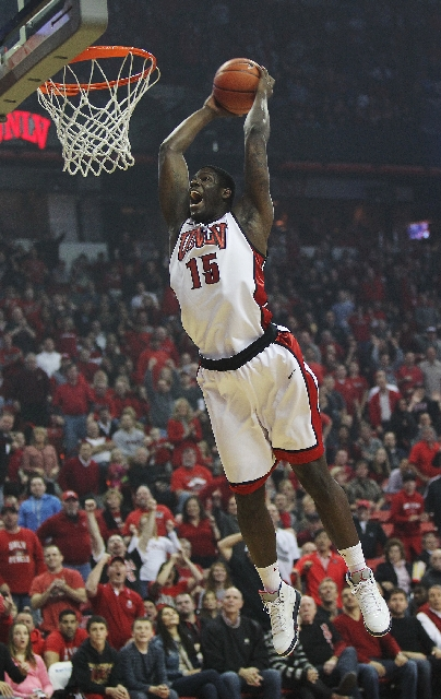 UNLV's Anthony Bennett dunks home two of his 17 points in a 64-55 victory Saturday over New Mexico. The freshman also had 12 rebounds.
