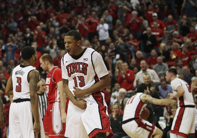 Bryce Dejean-Jones celebrates after UNLV won a fight for a loose ball against New Mexico at the Thomas & Mack Center on Saturday. Dejean-Jones scored 16 points in a 64-55 victory.