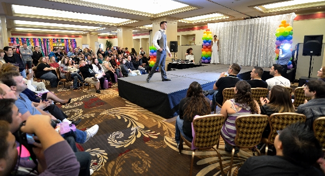 "Peter Bonifatto models formal wear Sunday during a fashion show at the ""Same Love, Same Rights"" LGBT Wedding Expo at Circus Circus. More than 300 people attended the event."