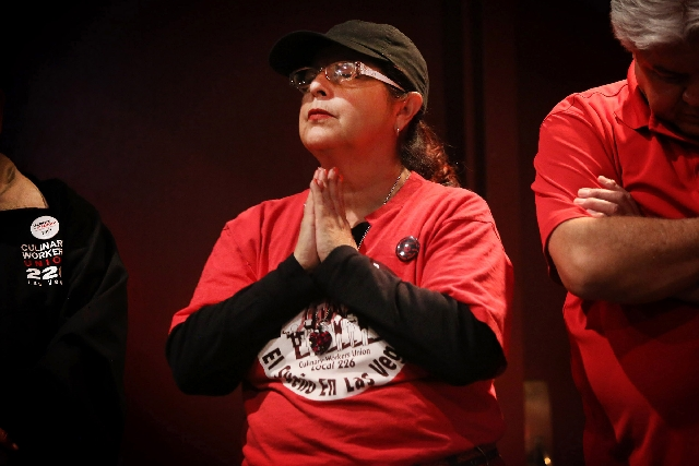 Mirna Preciado, director for the Culinary Local 226, prays Monday at the open of the union's meeting at Cashman Field.
