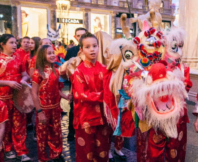 Students from The Meadows School march in a Chinese New Year's dragon parade Monday  at the Fashion Show mall. The school has been presenting the parade for 17 years.