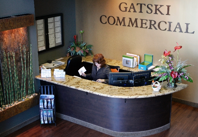Receptionist Rena Rohrer sorts mail at Gatski Commercial Real Estate Services. Gatski ranked third-best workplace among small companies.