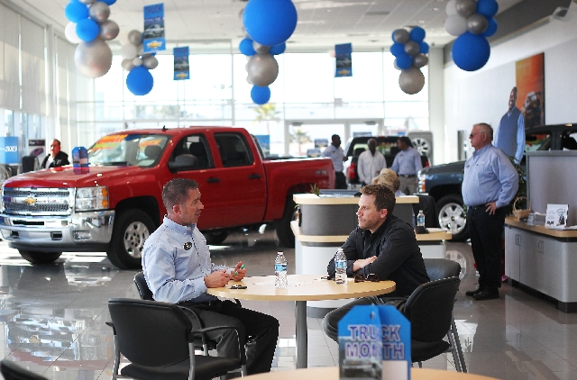 Beautiful Salesperson And Two Year Employee Tim Slaick, Left, Talks With Prospective  Car Buyer
