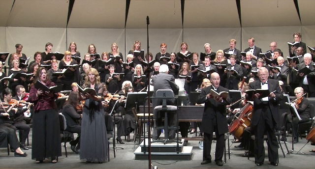 """Dr. Douglas Peterson conducts the Southern Nevada Musical Arts Society Chorus and  Orchestra during a performance of Handel's """"Judas Maccabaeus"""" in 2012."""