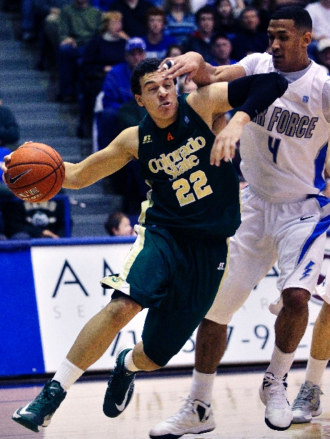 Colorado State's Dorian Green (22) drives as Air Force's Kamryn Williams covers him during the second half of Saturday's Mountain West game won by the Rams 89-86 in Air Force Aca ...