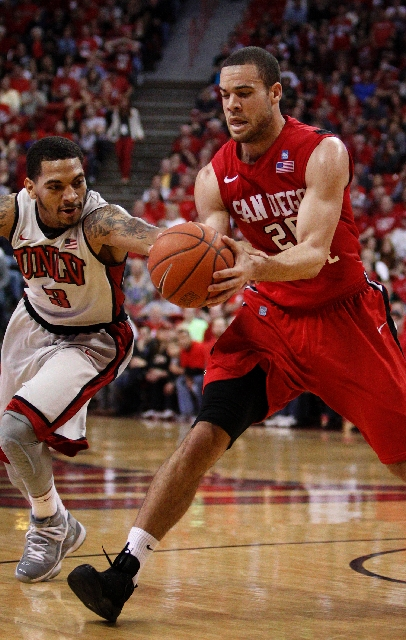 San Diego State's JJ O'Brien, right, battling for the ball with UNLV's Anthony Marshall, was held scoreless in the second half after scoring 15 in the first half Saturday.