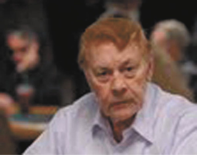 Los Angeles Lakers owner Jerry Buss is shown during a hand at the 2011 World Series of Poker at the Rio. Buss played in the annual event for decades, and his winnings in the WSOP totaled $45,926.  ...