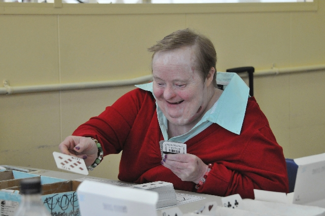 Ethel Sparling sorts a stack of cards by suit on her 59th birthday Jan. 14 at Progressive Choices.