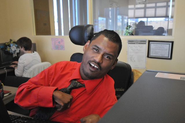 Marcus Olige watches the front desk Jan. 14 at Progressive Choices, 3000 Rigel Ave. The nonprofit organization helps intellectually disabled adults get vocational training and gain employment in t ...