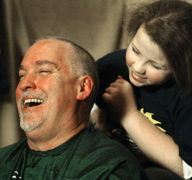 Las Vegas Review-Journal columnist John L. Smith and daughter Amelia share a laugh after she shaved his head during the 2011 McMullan's St. Baldrick's Day celebration. This year' ...