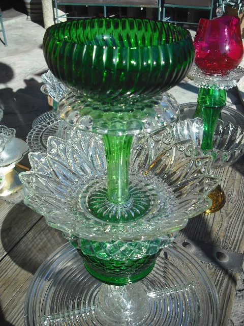 Assorted plates, bowls and vases have been transformed into candy dishes.