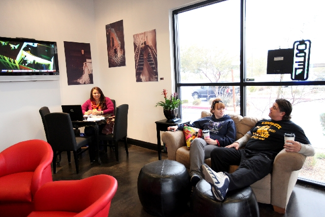 From left, Melissa Barishman, Allison Parra and Dion Niemo chat while enjoying their drinks and hanging out at the Tipsy Coffee House.
