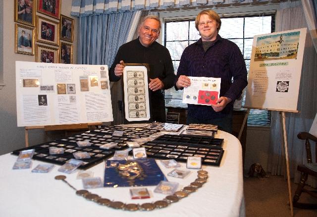 Las Vegas Numismatic Society President Joe Cavallaro, left, and his nephew, Chris Shands, pose with their coin collections at Shands' Henderson home.