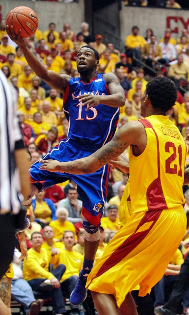 Kansas senior guard and Las Vegas native Elijah Johnson (15) shoots a layup against Iowa State's Will Clyburn in the first half Monday, on his way to a career-high 39 points in the No. 6 Jay ...