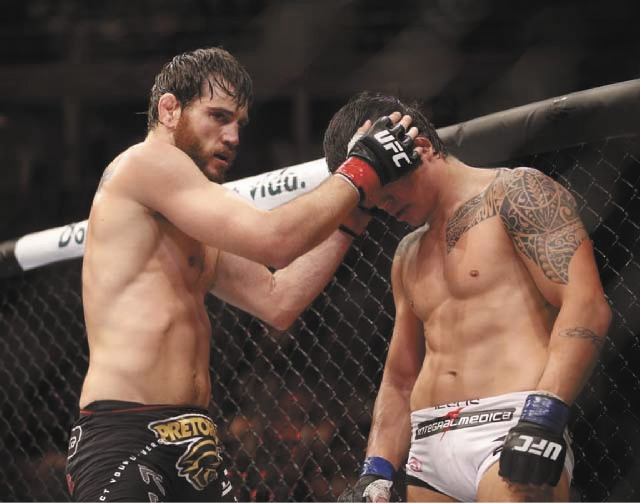 Welterweight Jon Fitch, left, fights Erick Silva at UFC 153 on Oct. 14 in Rio de Janeiro, Brazil. Fitch is the most prominent of 16 fighters let go last week by the Ultimate Fighting Championship.