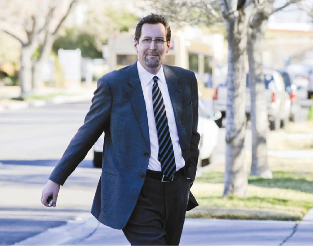 Chris Milam arrives at a law office in Las Vegas to give a sworn statement on Friday . The developer is the subject of a lawsuit in Henderson over a land deal.