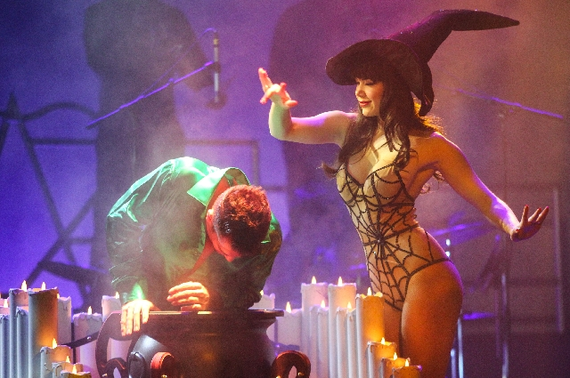 """""""Pin Up"""" star Claire Sinclair performs a Halloween-influenced segment with Ryan Kelsey during a preview of the show with the cast at the Stratosphere Feb. 25."""