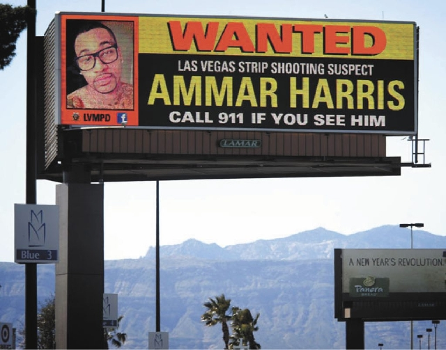 A billboard displaying a photo of Las Vegas Strip shooting suspect Ammar Harris is seen Tuesday off U.S. 95 between Valley View and Decatur boulevards. An arrest warrant has been issued for Harris ...
