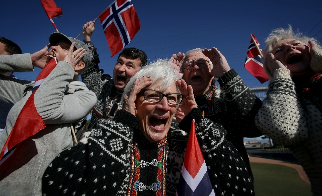 Jeanette Grove screams Wednesday with other members of the Vegas Viking Lodge of the Sons of Norway at the Welcome to Las Vegas sign on the Strip. The group screamed for the 150th anniversary of t ...