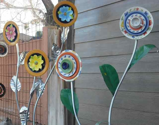An assortment of Honeymoon Blooms, flowers made from discarded plates, bowls and other pieces of dinnerware, adorn the yard of Matthew Kleindorfer's Las Vegas home.