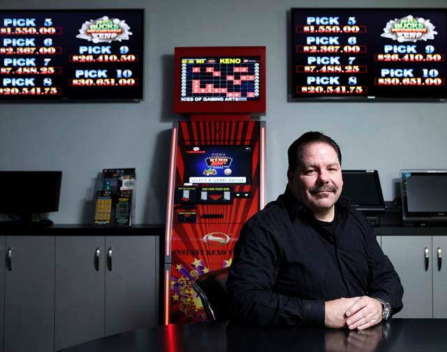John English, senior vice president of business development and public affairs at Z4 Gaming, poses Tuesday by his company's EZ Keno Kiosk at the company in Las Vegas.