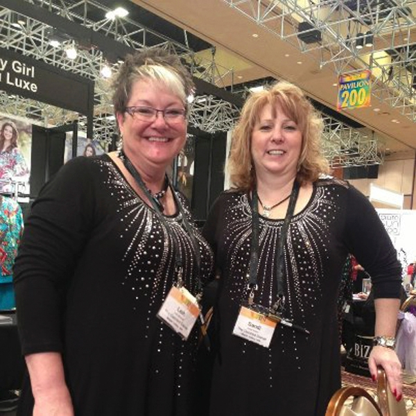 Sandra Sutton-Wasmund, right, is seen with Leih Mulvihill, her co-owner at The Dazzled Dame, a women's dress shop in Maple Valley, Wash. The two were in Las Vegas to attend a trade show at t ...