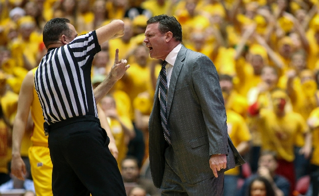 Referee Mark Whitehead calls a technical foul on Kansas coach Bill Self in the first half of the Jayhawks' victory over Iowa State on Monday. The Big 12 on Tuesday issued a formal acknowledg ...